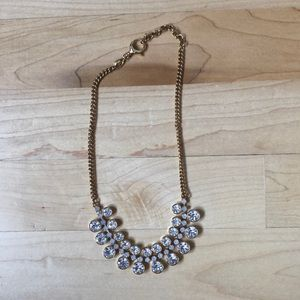 Gold tone and white crystal necklace